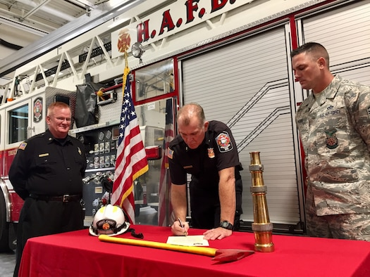 Brian Anderson, Hill deputy fire chief, signs a Fire Prevention Week proclamation Oct. 8, 2018, at Hill Air Force Base, Utah. (Courtesy photo)