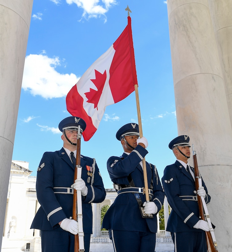 U.S. Air Force Honor Guard, Band join Commander Royal Canadian Air Force Lieutenant General Al Meinzinger and U.S. Air Force Chief of Staff General David Goldfein lay a wreath at the Tomb of the Unknown Soldier.