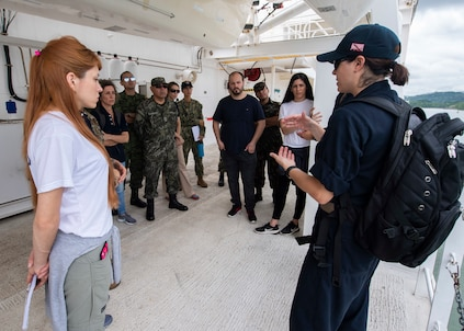 Lt. Carolina Garcia-Leahy, from Caracas, Venezuela, answers questions in Spanish to partner nation and non-governmental organizations during boat embarkation familiarization training aboard hospital ship USNS Comfort.