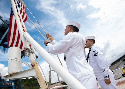 U.S. Navy Sailors shift colors as hospital ship USNS Comfort (T-AH 20) departs Panama City, Panama.