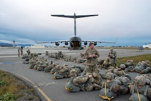 Army paratroopers from the 4th Infantry Brigade Combat Team (Airborne), 25th Infantry Division, U.S. Army Alaska, wait to board an Air Force C-17 Globemaster III, assigned to the 535th Airlift Squadron, out of Joint Base Pearl Harbor-Hickam, Hawaii, while participating in Arctic Anvil 19-01, at Joint Base Elmendorf-Richardson, Alaska, Oct. 9, 2018.