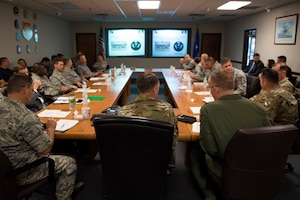 Lt. Gen. Warren D. Berry, deputy chief of staff of the Air Force for Logistics, Engineering and Force Protection, briefs with command teams from the 56th Fighter Wing and other F-35A Lightning II units on innovative integrated maintenance technician programs Oct. 4, 2018, at Luke Air Force Base, Ariz. Berry was briefed on ways in which different maintenance tasks on the F-35 could be integrated so that a single team of skilled experts can conduct the majority of aircraft maintenance without transition time between specialties. (U.S. Air Force photo by Senior Airman Ridge Shan)