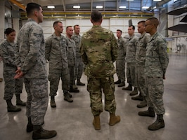Lt. Gen. Warren D. Berry, deputy chief of staff of the Air Force for Logistics, Engineering and Force Protection, speaks with 56th Maintenance Group Airmen during a visit to evaluate innovative integrated maintenance technician programs Oct. 4, 2018, at Luke Air Force Base, Ariz. Berry discussed the programs, and ongoing evaluations for potential adoption of these programs Air Force-wide. (U.S. Air Force photo by Senior Airman Ridge Shan)