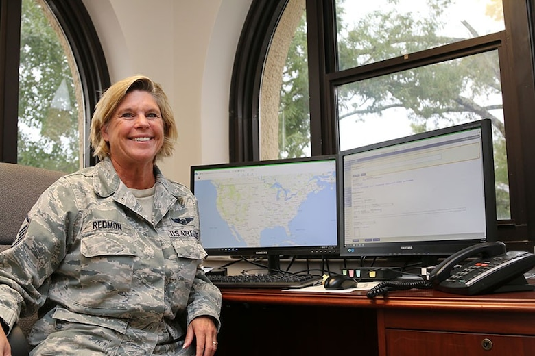 Master Sgt. Kristen Redmon, a Tyndall Air Force Base civilian reservist, works in a temporary office at Maxwell Air Force Base overlooking the National Operations Center at Civil Air Patrol National Headquarters. Redmon relocated to Maxwell AFB, Ala., before Hurricane Michael hit the Tyndall AFB area. (Civil Air Patrol photo by Susan Schneider)