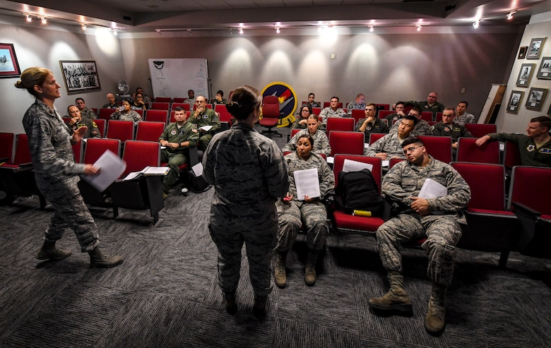 Air Force Safety Center Human Factor Workshop instructors, Maj. Nancy Delaney, left, and Maj. Heather Tevebaugh, brief students during their course at Joint Base Langley-Eustis, Virginia, Oct. 10, 2018. In this iteration of the course, the entire class of students and the instructors all came from the aerospace and operational physiology career field and are used as subject-matter experts during accident investigation boards. During this course students learned about how human factors are involved in occupational safety and accident investigation boards. (U.S. Air Force photo by Tech. Sgt. Nick Wilson)