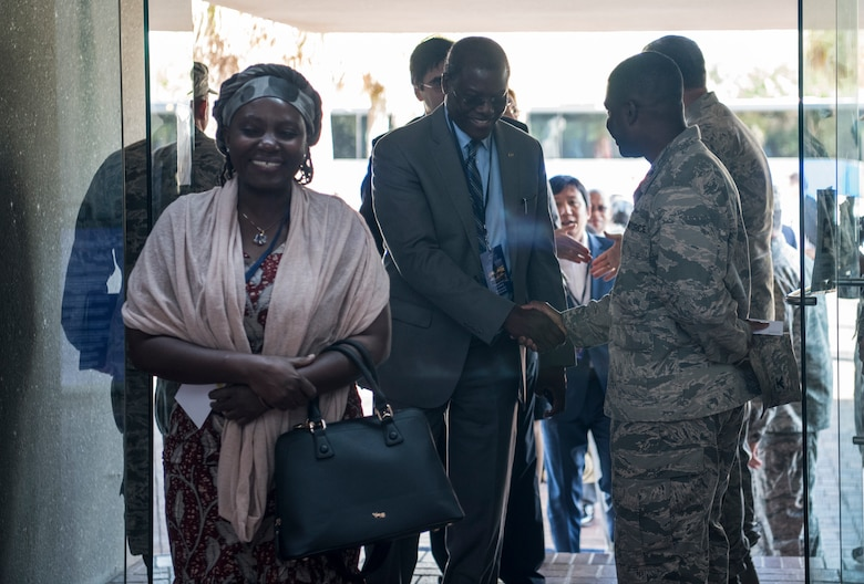 U.S. Air Force Col. Terrence Adams, right, greets the foreign ambassadors and spouses walking into the wing headquarters building Oct. 15, 2018, at Joint Base Charleston, S.C. Hosting the ambassadors allowed JB Charleston to showcase its warfighting capabilities and assets, while also building relations with key representatives from around the globe.