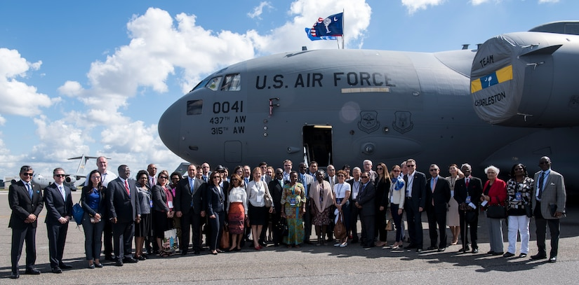 More than 30 foreign ambassadors and their spouses stand in front of a C-17 Globemaster III during their Experience America trip Oct. 15, 2018, at Joint Base Charleston. Hosting the ambassadors allowed JB Charleston to showcase its warfighting capabilities and assets, while also building relations with key representatives from around the globe.