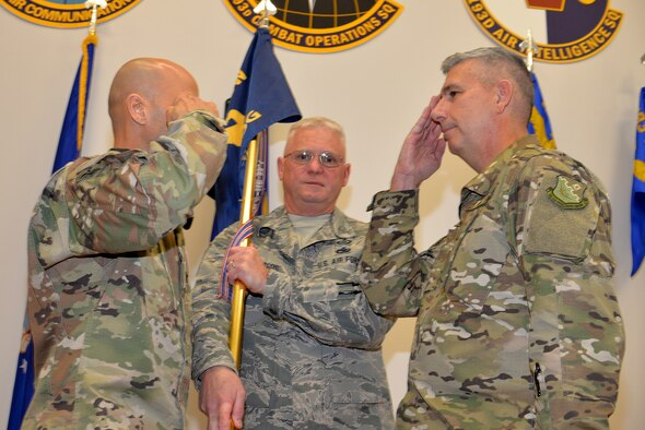 """Col. Scott Harron (right), 193rd Air Operations Group commander, is appointed commander of the group Oct. 18, 2018, by Col. Terrence Koudelka (left), 193rd Special Operations Wing commander, during an assumption of command ceremony at the AOG, a unit of the wing located next to the airport in State College, Pa. Before taking on the role as AOG commander, Harron served as the 25th Air Force Inspector General, and as Inspection Team Chief at Air Combat Command headquarters. He also served as commander of the 152nd Air Intelligence Squadron at Hancock Field Air National Guard Base, Mattydale, N.Y. """"Scott is the absolute perfect person for this position. His intel experience and track record of deployments is nothing short of impressive,"""" Koudelka said. (U.S. Air National Guard photo by 1st Lt. Susan Penning/Released)"""