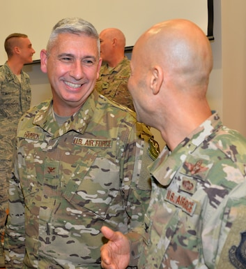 """Col. Scott Harron (left), 193rd Air Operations Group commander, speaks with Col. Terrence Koudelka, 193rd Special Operations Wing commander, following Harron's assumption of command ceremony at the AOG in State College, Pa., Oct. 18. Before taking on the role as AOG commander, Harron served as the 25th Air Force Inspector General, and as Inspection Team Chief at Air Combat Command headquarters. He also served as commander of the 152nd Air Intelligence Squadron at Hancock Field Air National Guard Base, Mattydale, N.Y. Harron spent 16 years as an enlisted troop before commissioning as an Air Force intelligence officer in September 2000. """"Scott is the absolute perfect person for this position. His intel experience and track record of deployments is nothing short of impressive,"""" Koudelka said. (U.S. Air National Guard photo by 1st Lt. Susan Penning/Released)"""