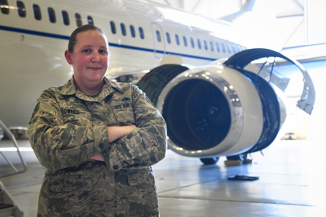 Tech. Sgt. Kelly Downes, a 213th Air Maintenance Squadron phase inspector, stands in front of a 113th Wing C-40 at Andrews Air Force Base, Oct. 17. Downes rescued her 91 year-old neighbor from a house fire caused by a fallen heat lamp in Essex, Md. (U.S. Air National Guard photo by Staff Sgt. Erica Rodriguez)