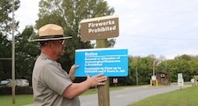 Aaron Boswell, a ranger for the Little Rock District, installs looting signage at one of the Corps' many parks. Signage is now being placed at Corps parks in order to bring exposure to the penalties one will incur if found in violation of the law. Not only will perpetrators face prison time up to 5 years without parole, fines can also amount to $250,000.