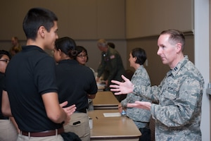 Captain Kevin Batik, 301st Fighter Wing Assistant Staff Judge Advocate, speaks with a Texas Christian University Reserver Officer Training Corps Cadet during the TCU Detachment 845 Career Day, October 18. Reserve Citizen Airmen from Tenth Air Force took part in the event to help cadets learn about the different career opportunities available upon commissioning.