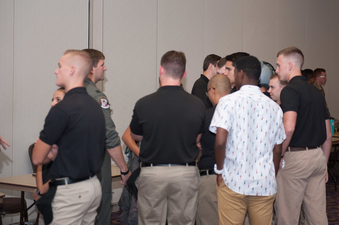 Members of the 301st Fighter Wing's 457th Fighter Squadron, speak with Texas Christian University Reserve Officer Training Corps Cadets during the TCU Detachment 845 Career Day, October 18. Reserve Citizen Airmen from multiple Tenth Air Force units took part in the event to help cadets learn about the different career opportunities available upon commissioning.