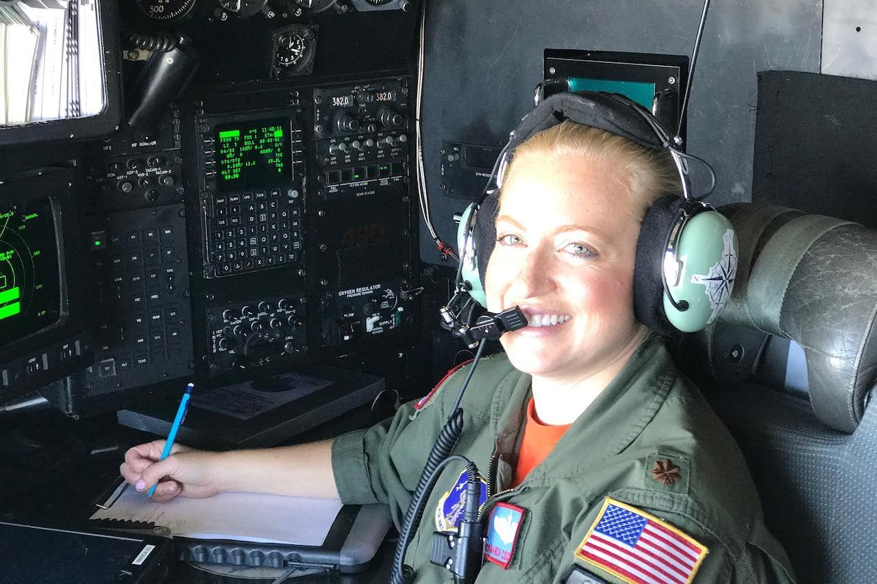 Air Force navigator works inside plane.