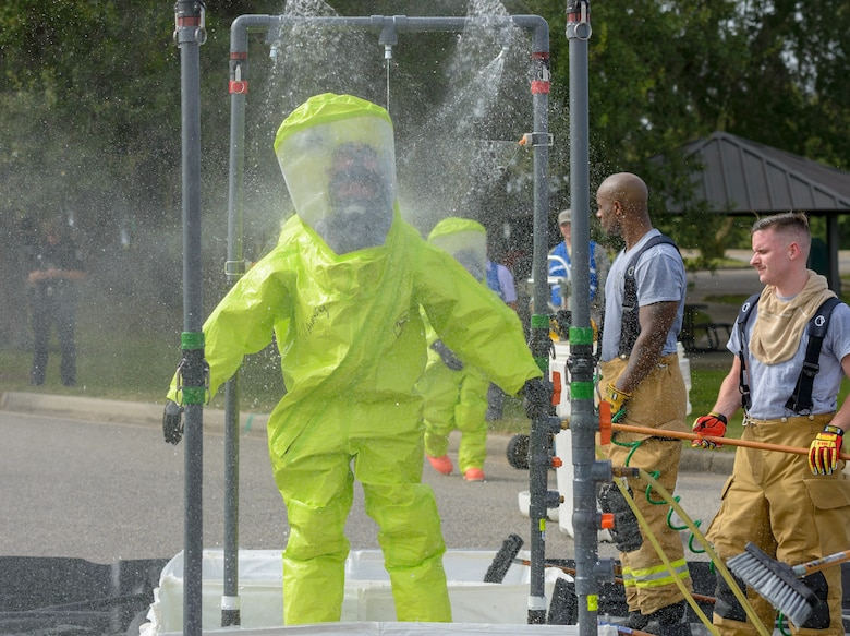 Keesler firefighters go through the decontamination site during the Anti-Terrorism, Force Protection Condition and Chemical, Biological, Radiological, Nuclear and high-yield Explosives training exercise at the Marina on Keesler Air Force Base, Mississippi, Oct. 17, 2018. The AT/FPCON/CBRNE exercise was conducted to evaluate the mission readiness and security of Keesler. (U.S. Air Force photo by Andre' Askew)