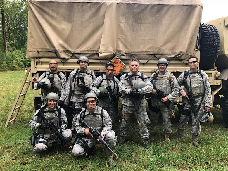 Members of the Air Force Reserve's 44th Aerial Port Squadron based out of Andersen Air Force Base, Guam, participate in the Fieldcraft Hostile Course Sept. 17-28, 2018, at Joint Base McGuire-Dix-Lakehurst, New Jersey. Back row: Tech. Sgt. Noli Pegarido, Senior Master Sgt. Rhodel Sevilla, Master Sgt. Edgar Tiamzon, Master Sgt. Peter Martinez, Maj. Brian Eichers from the 27th APS, Minneapolis, Minn, and Tech. Sgt. Charles Hinkle. Front row: Staff Sgt. Jerome Larimer and Senior Airman Matthew Mira. Guam took home both of the end of course awards best attitude and unofficial leader. Special shout out to Tech. Sgt. Charles Hinkle and Senior Airman Mira for earning the awards. The fast-paced course provides Airmen the skills, knowledge and abilities necessary to perform in a hostile environment while allowing freedom of movement on the battlefield. The students participated in realistic and strenuous training scenarios used to teach skills in weapons firing, communications, mounted and dismounted individual and team movements, and map, compass, and GPS navigation. (Courtesy photo)