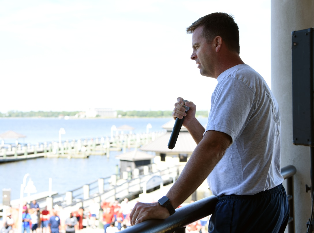 U.S. Air Force Col. Lance Burnett, 81st Training Wing vice commander, delivers remarks to Keesler personnel during Wingman Day at the Marina on Keesler Air Force Base, Mississippi, Oct. 18, 2018. Wingman Day focused on the physical domain, resiliency and team-building initiatives across the base followed by a barbeque and games. (U.S. Air Force photo by Kemberly Groue)