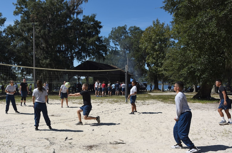 Keesler Airmen participate in a game of volleyball during Wingman Day at the Marina on Keesler Air Force Base, Mississippi, Oct. 18, 2018. Wingman Day focused on the physical domain, resiliency and team-building initiatives across the base followed by a barbeque and games. (U.S. Air Force photo by Kemberly Groue)