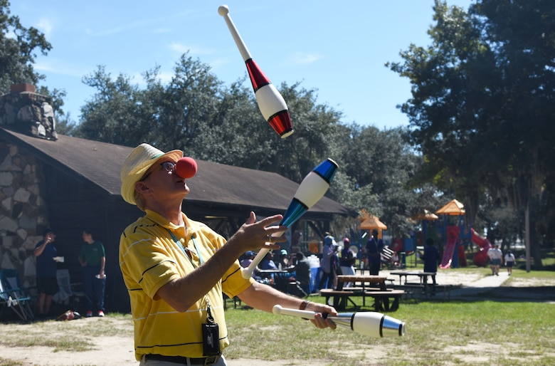 Barry Newman, 81st Training Wing sexual assault response coordinator, juggles for Keesler personnel during Wingman Day at the Marina on Keesler Air Force Base, Mississippi, Oct. 18, 2018. Wingman Day focused on the physical domain, resiliency and team-building initiatives across the base followed by a barbeque and games at the Marina. (U.S. Air Force photo by Kemberly Groue)
