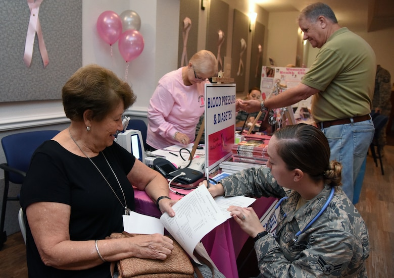 U.S. Air Force Airman 1st Class Jacquelyn Gucciardi, 81st Medical Operations Squadron medical technician, logs the blood pressure count of Joan Hershberge, spouse of retired Col. David Hershberge (deceased), during the 7th Annual Mammothon Cancer Screening and Preventative Health Fair inside the Don Wylie Auditorium on Keesler Air Force Base, Mississippi, Oct. 19, 2018. The 81st Medical Group hosted the walk-in event which included screenings for multiple types of cancer and chronic diseases in honor of Breast Cancer Awareness Month. (U.S. Air Force photo by Kemberly Groue)
