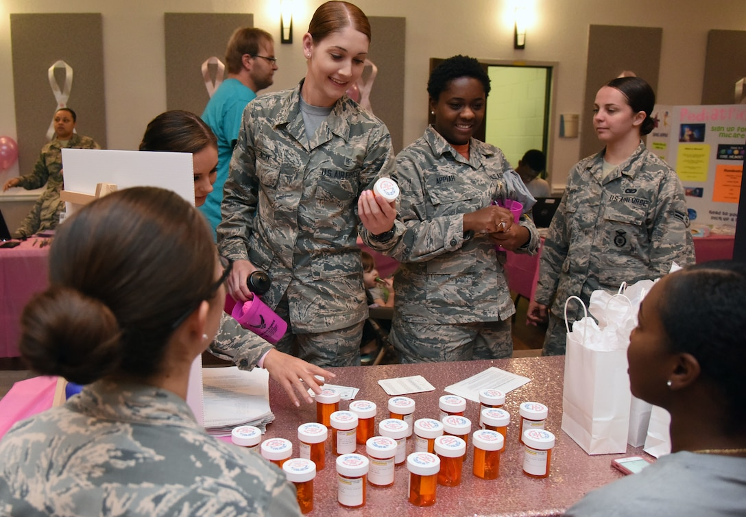 Keesler personnel observes medicine bottles filled with candy during the 7th Annual Mammothon Cancer Screening and Preventative Health Fair inside the Don Wylie Auditorium on Keesler Air Force Base, Mississippi, Oct. 19, 2018. The 81st Medical Group hosted the walk-in event which included screenings for multiple types of cancer and chronic diseases in honor of Breast Cancer Awareness Month. (U.S. Air Force photo by Kemberly Groue)