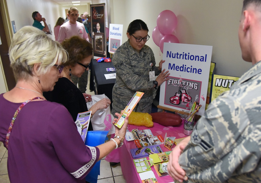 U.S. Air Force Airman Veronica Castro, 81st Aerospace Medicine Squadron diet therapy technician, provides information about nutritional medicine to attendees during the 7th Annual Mammothon Cancer Screening and Preventative Health Fair inside the Don Wylie Auditorium on Keesler Air Force Base, Mississippi, Oct. 19, 2018. The 81st Medical Group hosted the walk-in event which included screenings for multiple types of cancer and chronic diseases in honor of Breast Cancer Awareness Month. (U.S. Air Force photo by Kemberly Groue)