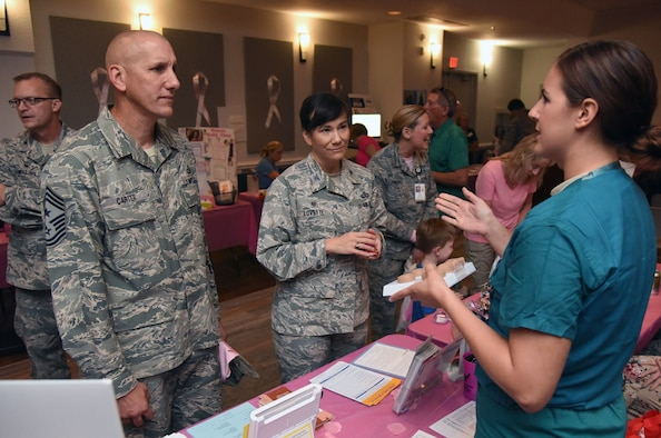 U.S. Air Force Staff Sgt. Hallie Neel, 81st Surgical Operations Squadron urology technician, provides a brief urology overview to Chief Master Sgt. Kenneth Carter, 81st Training Wing command chief, and Col. Debra Lovette, 81st TRW commander, during the 7th Annual Mammothon Cancer Screening and Preventative Health Fair inside the Don Wylie Auditorium on Keesler Air Force Base, Mississippi, Oct. 19, 2018. The 81st Medical Group hosted the walk-in event which included screenings for multiple types of cancer and chronic diseases in honor of Breast Cancer Awareness Month. (U.S. Air Force photo by Kemberly Groue)