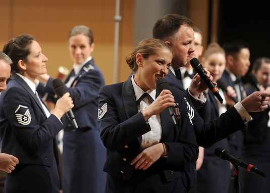 Technical Sgt. Hillary Grobe, an alto vocalist with the Singing Sergeants, performs Oct. 17, 2018, at Cleveland High in Rio Rancho, N.M. along with the Sergeants and the Air Force Concert Band. (U.S. Air Force photo by Todd Berenger)