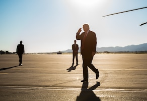 President Donald J. Trump returns a salute to 56th Fighter Wing leadership upon arrival to Luke Air Force Base, Ariz., Oct. 19, 2018. President Trump visited the base to discuss military weapons and technology capabilities and learn about the 56th Fighter Wing's pilot training mission. (U.S. Air Force photo by Senior Airman Alexander Cook)