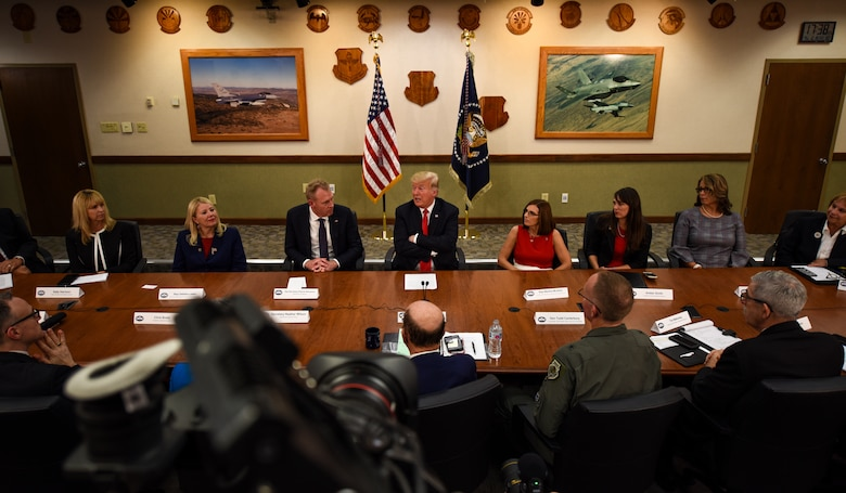 President Donald J. Trump engages in a roundtable discussion with cabinet members, congressmen, and defense industry leaders Oct. 19, 2018, at Luke Air Force Base, Ariz. The discussion focused on a variety of topics including cybersecurity, foreign military sales, and technological advancement. (U.S. Air Force photo by Senior Airman Ridge Shan)