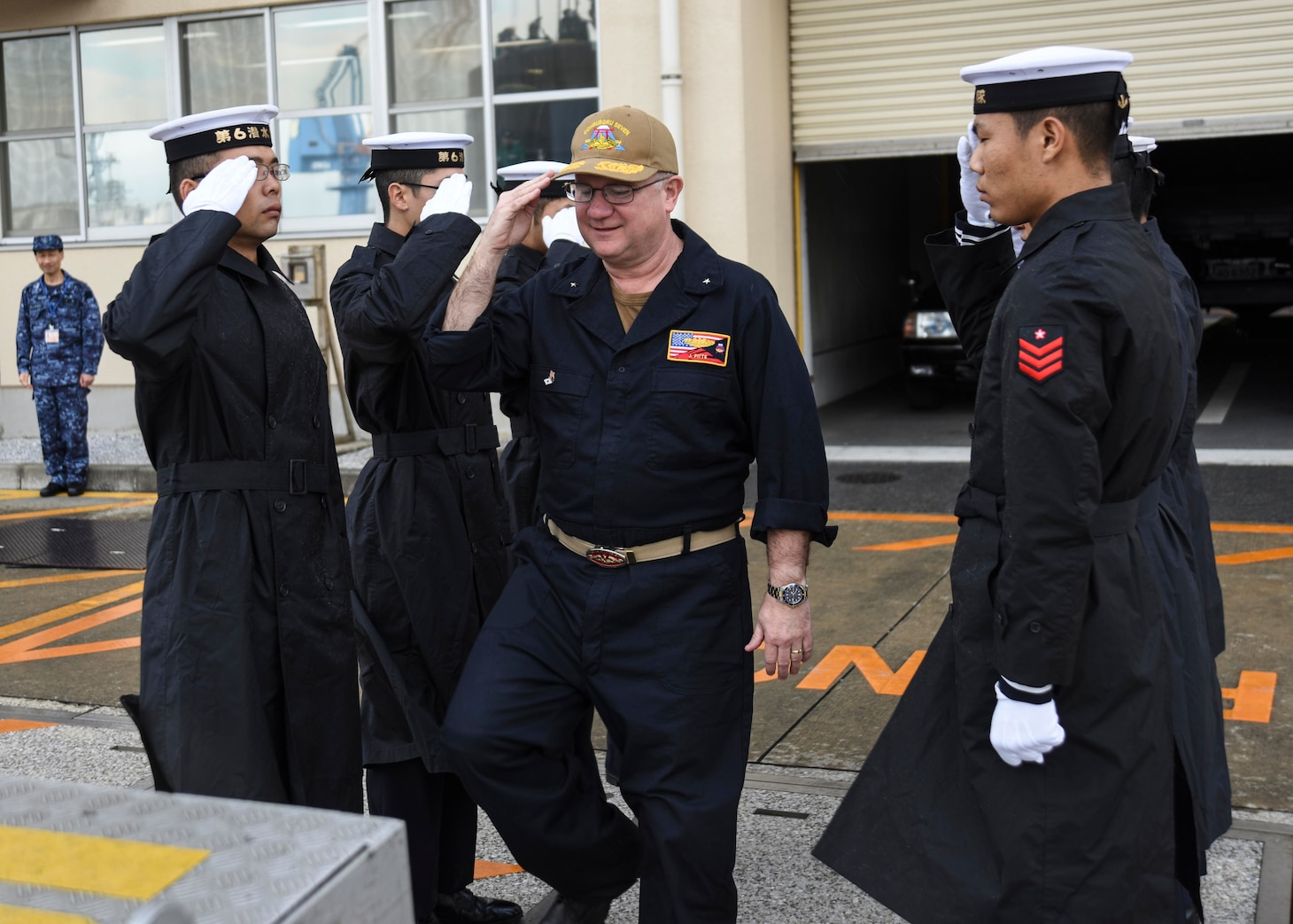 FLEET ACTIVITIES YOKOSUKA, Japan (Oct. 19, 2018) Rear Adm. Jimmy Pitts, Commander, Submarine Group 7, salutes Japan Maritime Self-Defense Force Sailors as he is whistled aboard JS Seiryu (SS-509), prior to going underway aboard the Japanese submarine. The familiarity cruise is to reinforce the submarine group's commitment to the U.S.-Japan alliance.