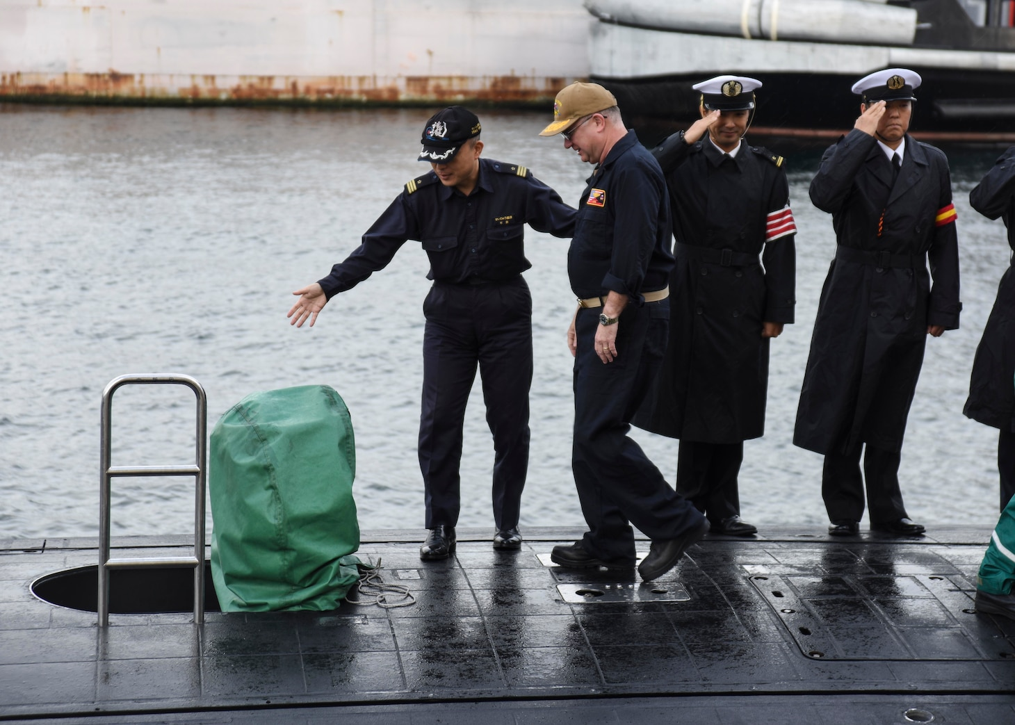 FLEET ACTIVITIES YOKOSUKA, Japan (Oct. 19, 2018) Rear Adm. Jimmy Pitts, Commander, Submarine Group 7, is welcomed aboard JS Seiryu (SS-509) by Cmdr. Takehiko Hirama, commanding officer of Seiryu, prior to going underway aboard the Japanese submarine. The familiarity cruise is to reinforce the submarine group's commitment to the U.S.-Japan alliance.
