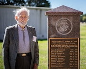 U.S Marine veteran, Blair Mckenzie, poses for a photo next to his class memorial, Marine Corps Base Quantico, Oct. 18, 2018. The service members got together for the reunion of The Basic School's first special basic class of 1950, some of whom served together in Korea.