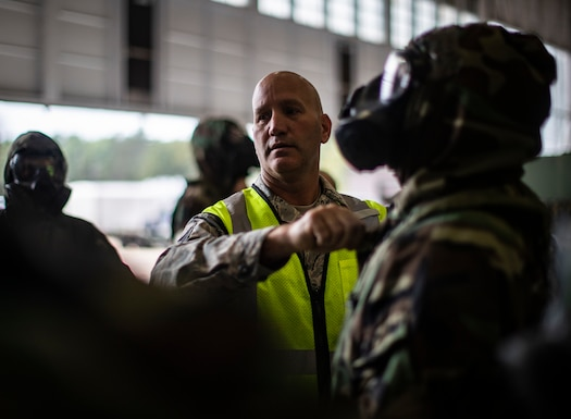 Staff Sgt. Andrew Marsala instructs the proper fit of the JLIST suit during an ability to survive and operate training class on Joint Base McGuire-Dix-Lakehurst, N.J., Oct. 20, 2018. The class included decontamination procedures, self aid and buddy care, and proper wear of the M50 gas mask. Marsala is assigned to the 108th Civil Engineering Squadron's Emergency Management Office
