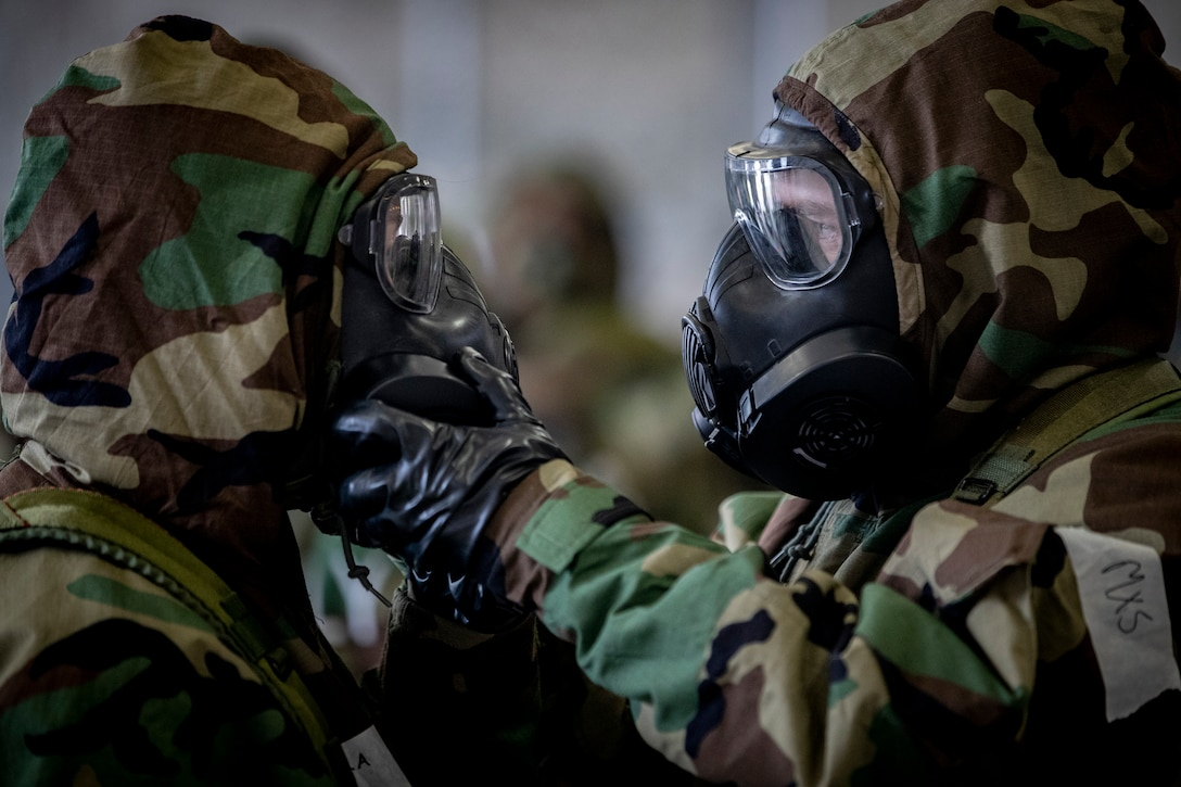 U.S. Air National Guard Airmen from the 108th Wing practice replacing filters on their M50 gas masks during an ability to survive and operate training class on Joint Base McGuire-Dix-Lakehurst, N.J., Oct. 20, 2018. The class included decontamination procedures, self aid and buddy care, and proper wear of the M50 gas mask.