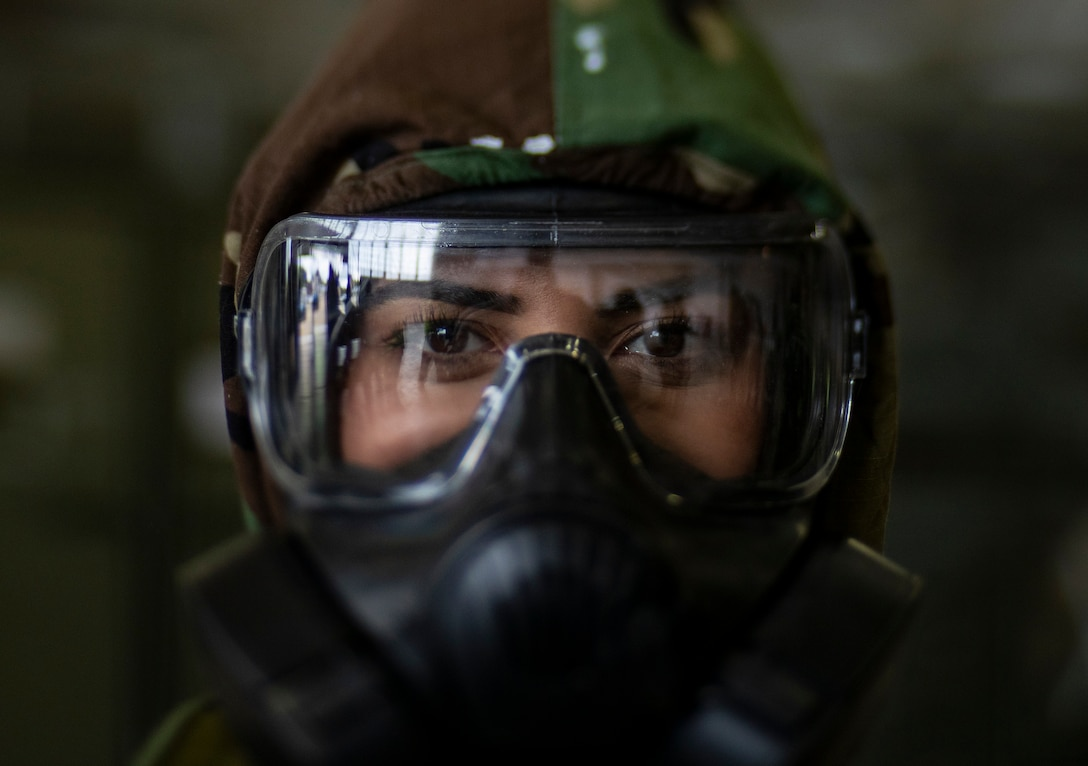 Senior Airman Eusaybia Parker wears her M50 gas mask during an ability to survive and operate training class on Joint Base McGuire-Dix-Lakehurst, N.J., Oct. 20, 2018. The class included decontamination procedures, self aid and buddy care, and proper wear of the M50 gas mask. Parker is assigned to the 108th Wing's Maintenance Operations Flight.