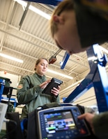 U.S. Air Force Tech. Sgt. Katelyn Goorhouse and Staff Sgt. Taylor Nielsen, 109th Aeromedical Evacuation Squadron, perform a pre-flight equipment check in St. Paul, Minn., Oct. 9, 2018.