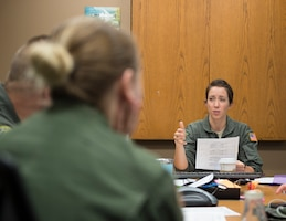 U.S. Air Force Maj. Meghan Grout, 109th Aeromedical Evacuation Squadron, leads the mission brief in St. Paul, Minn., Oct. 9, 2018.