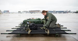 U.S. Air Force Staff Sgt. Taylor Nielsen, 109th Aeromedical Evacuation Squadron, prepares litters to be transported onto the C-130 Hercules in St. Paul, Minn., Oct. 9, 2018.