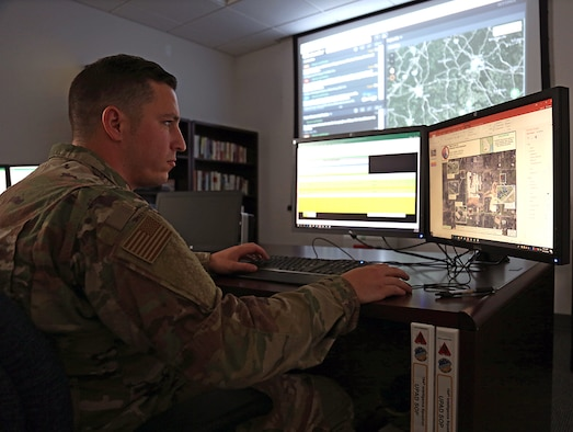 Senior Airman Jeffrey Andrews, a geospatial targeting analyst with the 194th Intelligence Squadron assigned to the Washington Air National Guard, looks at imagery of a Federal Emergency Management Agency (FEMA) distribution center Oct. 14, 2018 at Camp Murray, Wash.