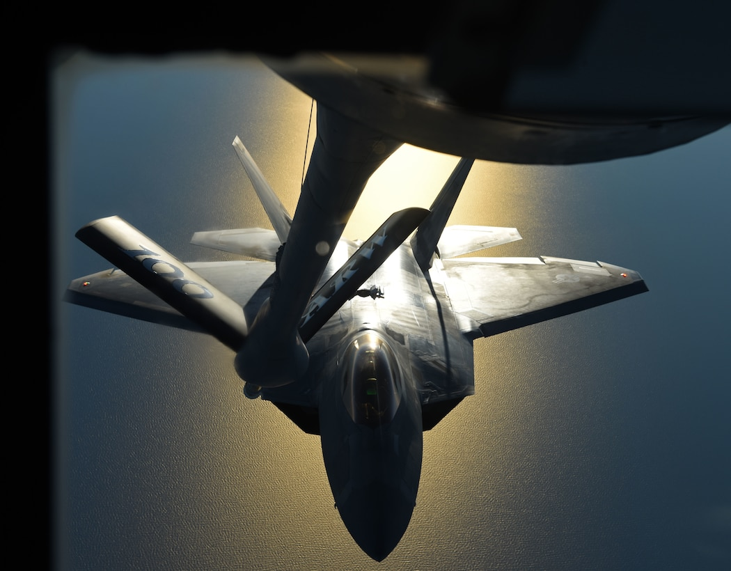 A U.S. Air Force F-22 Raptor flies behind a U.S. Air Force KC-135 Stratotanker during aerial refueling training off the coast of Finland, Oct 19, 2018. The Raptors deployed from the 27th Fighter Squadron, Joint Base Langley-Eustis, Va. and arrived in Europe Oct. 5. (U.S. Air Force photo by Senior Airman Luke Milano)