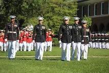 """Marines with the Marine Barracks Washington D.C. parade marching staff execute """"eyes right"""" during a parade for retired U.S. Marine Corps Sgt. Maj. John L. Canley, the 298th Marine Medal of Honor recipient at the Barracks, Oct. 19, 2017."""