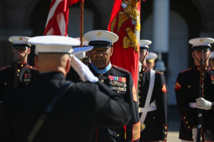 Retired U.S. Marine Corps Sgt. Maj. John L. Canley, the 298th Marine Medal of Honor recipient, renders a salute during a parade for Canley at Marine Barracks Washington D.C., Oct. 19, 2017.