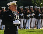 Commandant of the Marine Corps, Gen. Robert B. Neller, speaks to guests attending a parade for retired U.S. Marine Corps Sgt. Maj. John L. Canley, the 298th Marine Medal of Honor recipient at Marine Barracks Washington D.C., Oct. 19, 2017.