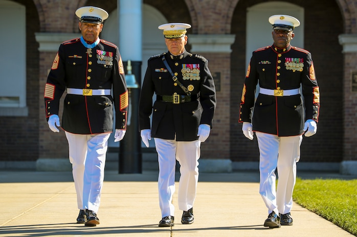 Retired U.S. Marine Corps Sgt. Maj. John L. Canley, the 298th Marine Medal of Honor recipient, left, Commandant of the Marine Corps, Gen. Robert B. Neller, center, and Sergeant Major of the Marine Corps, Sgt. Maj. Ronald L. Green, right, walk down center walk during a parade for Canley at Marine Barracks Washington D.C., Oct. 19, 2017.