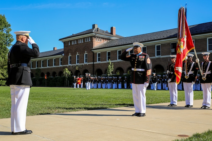 Commandant of the Marine Corps, Gen. Robert B. Neller, left, salutes retired U.S. Marine Corps Sgt. Maj. John L. Canley, the 298th Marine Medal of Honor recipient, during a parade for Canley at Marine Barracks Washington D.C., Oct. 19, 2017.