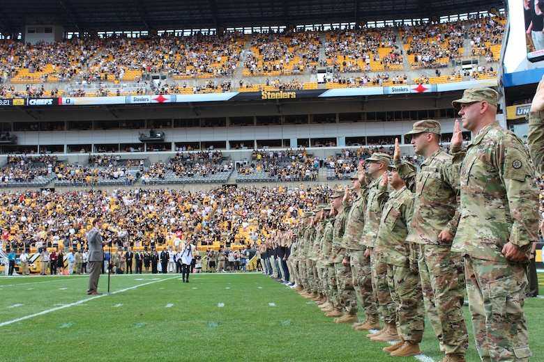 SECARMY gives the Oath at mass enlistment ceremony at Steelers game