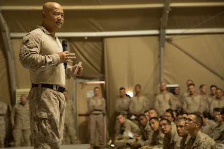 UNDISCLOSED LOCATION, SOUTHWEST ASIA - U.S. Marine Corps Sgt. Maj. Chuong Ngyuen, the sergeant major of Special Purpose Marine Air-Ground Task Force, Crisis Response-Central Command, speaks to Marines and Sailors during a town hall meeting Oct. 19, 2018. During the town hall, the SPMAGTF-CR-CC Commanding Officer and Sergeant Major briefed Marines on operations in the region. (U.S. Marine Corps photo by Cpl. Teagan Fredericks)