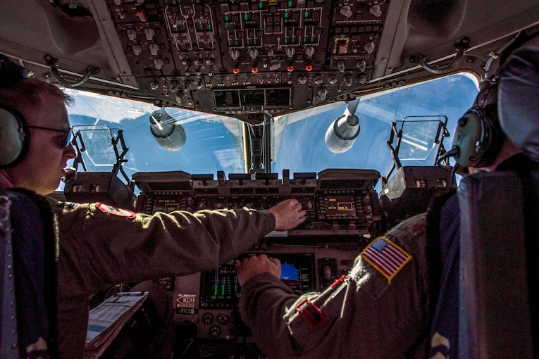 Two Ari Force captains conduct mid-air refueling.