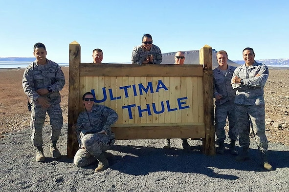 THULE AIR BASE, Greenland – Capt. Stephen Caple (second from right), 821st Support Squadron Civil Engineer flight commander, stands with his civil engineer flight next to a sign at Thule Air Base, Greenland. Caple has a team of six Airmen responsible for Air Force engineering operations as contracting officers' representatives providing oversight to approximately 220 contractors. (Courtesy photo)